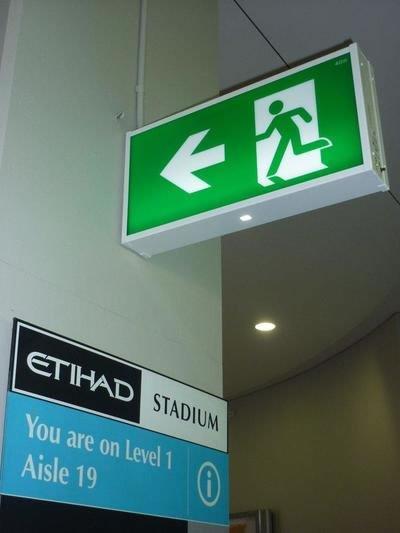exit lights at a stadium